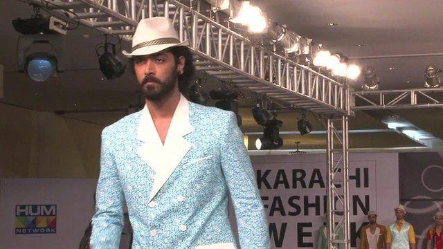 A male model on a catwalk