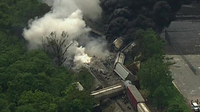 Derailed train carriages and smoke