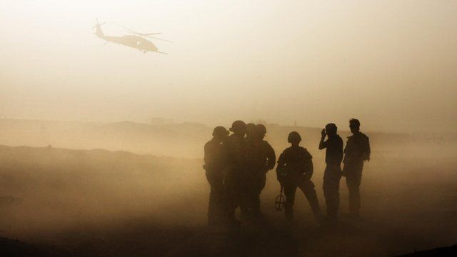 British soldiers silhouetted during training in Helmand. Oct 2009.