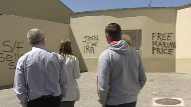 The culture minister and colleagues view the graffiti