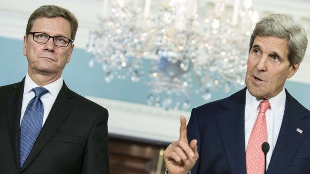 German Minister of Foreign Affairs Guido Westerwelle(L) listens while US Secretary of State John Kerry speaks during a press conference at the US State Department May 31, 2013 in Washington