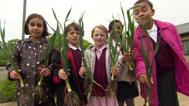 Children holding leeks