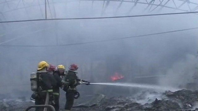 Scene inside burnt out poultry plant, Dehui in Jilin province, China