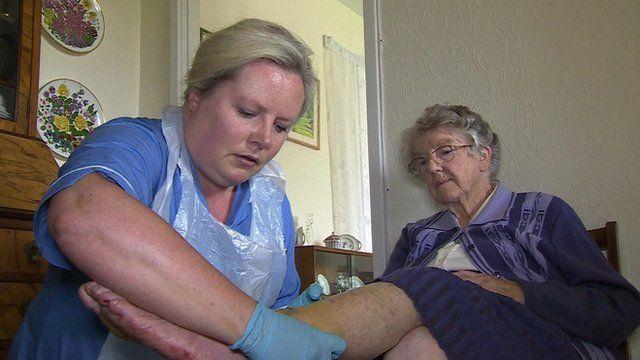 A district nurse with a patient