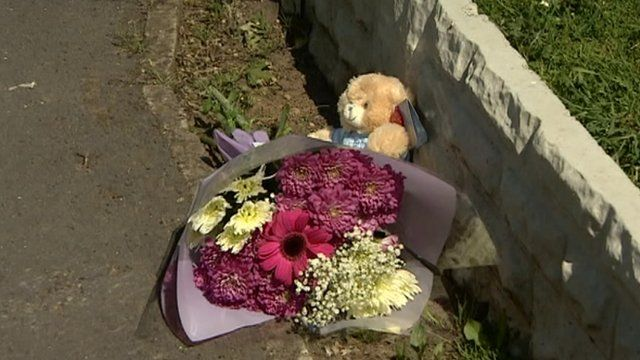 Flowers and teddy bear at the scene