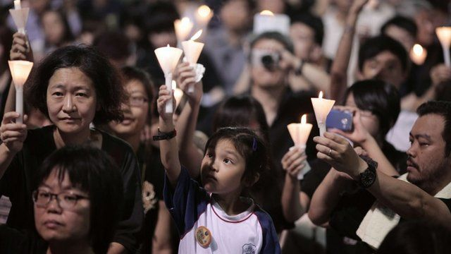 A child takes part in a candlelight vigil held to mark the 24th anniversary of the 1989 crackdown at Tiananmen Square, in Hong Kong, on June 4, 2013