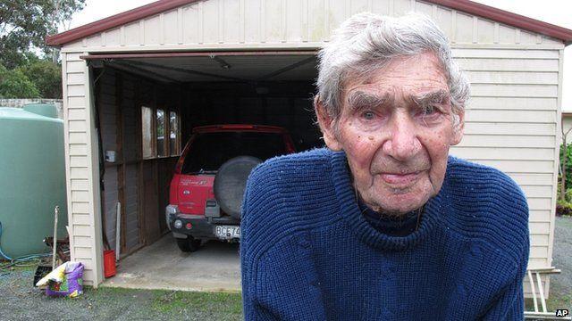 Bob Edwards at home with his car