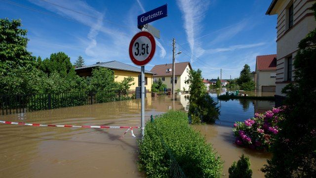 "Flooded streets can be seen in Dresden""s Gohlis district"