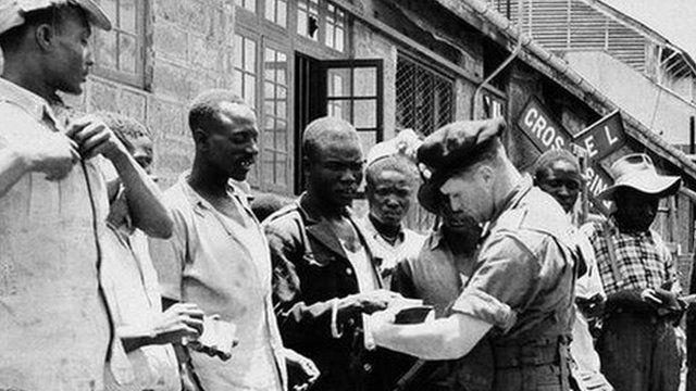 British soldiers quizzing Kenyan men