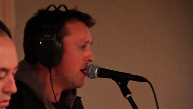 Graeme Swann sings down a microphone