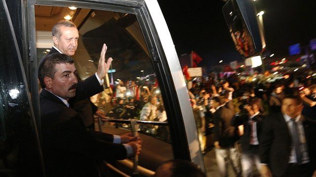 Turkish Prime Minister Recep Tayyip Erdogan waves to crowds