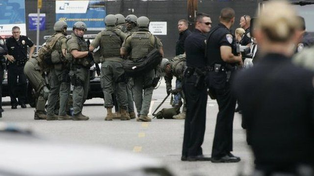 Police officers gather during a search at Santa Monica College