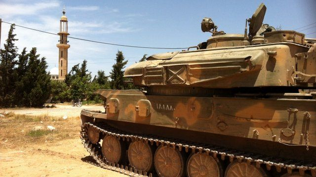 """A Syrian army tank parked in Dabaa, north of Qusayr, in Syria""""s central Homs province"""