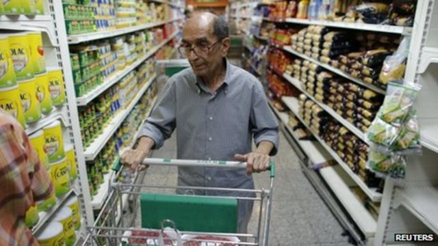 Venezuela's Maduro scraps plan for food restriction