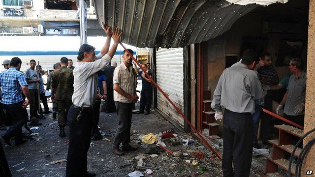 A damaged shop at a scene of two explosions in the central district of Marjeh, Damascus