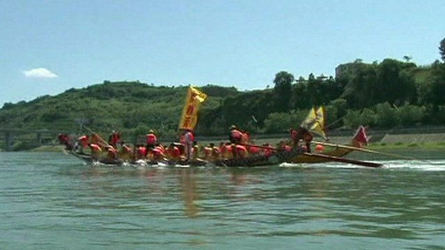 A boat racing in the Dragon Boat Festival