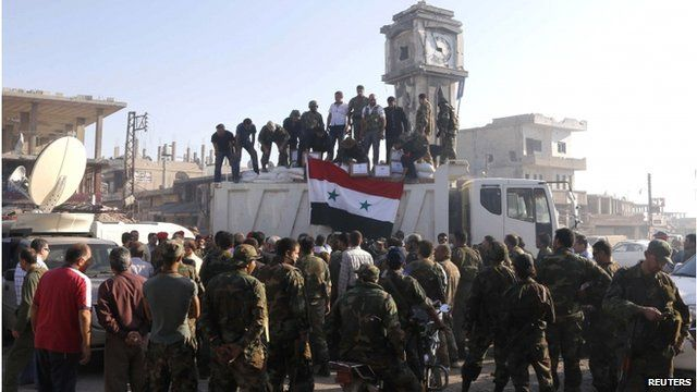 Soldiers loyal to the Syrian regime