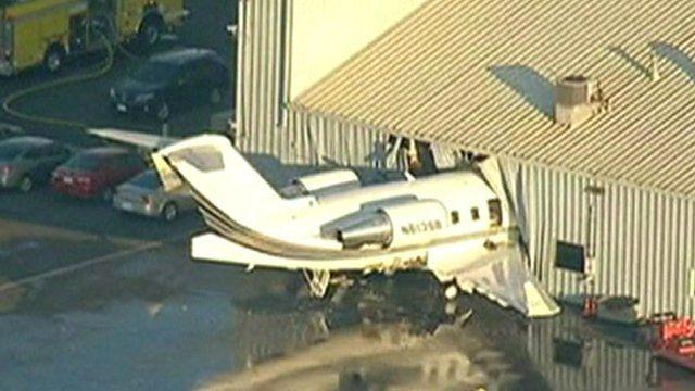 Plane crashes into hangar
