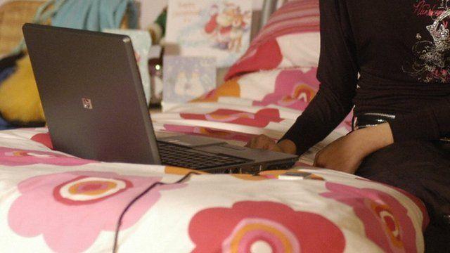 Teenage girl uses laptop