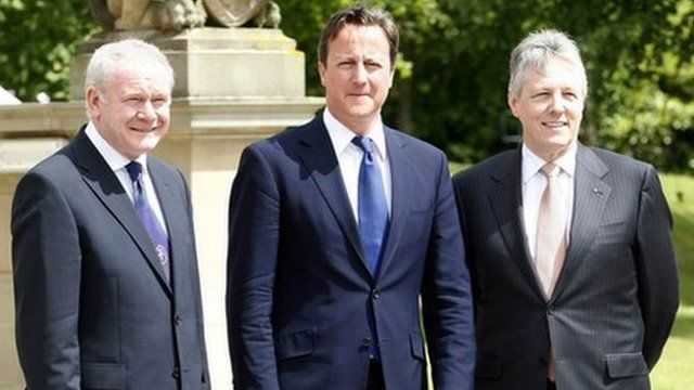 Prime Minister David Cameron with Martin McGuinness and Peter Robinson at Stormont Castle (archive)