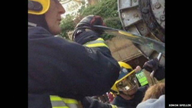 Firemen cutting passengers free