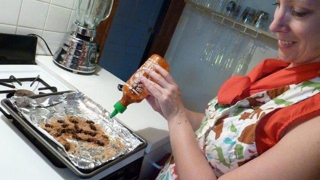 Biologist Jenna Jadin prepares Caramelised Brood II cicadas