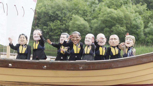 Caricatures of G8 leaders on bikes