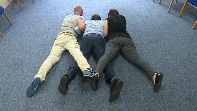 Mental health professionals restraining Sheffield Mental Health Trust's Professor Tim Kendall