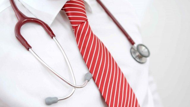 A stethoscope around a doctor's neck
