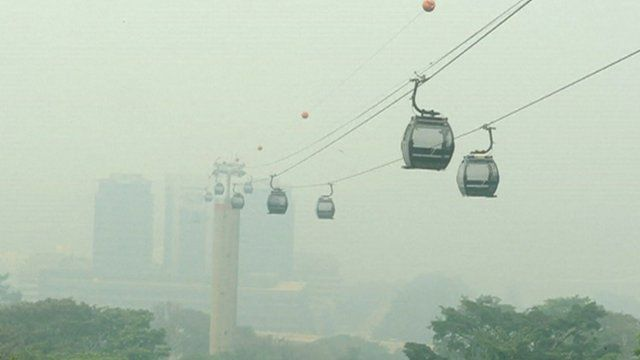 Cable cars in a haze of smog