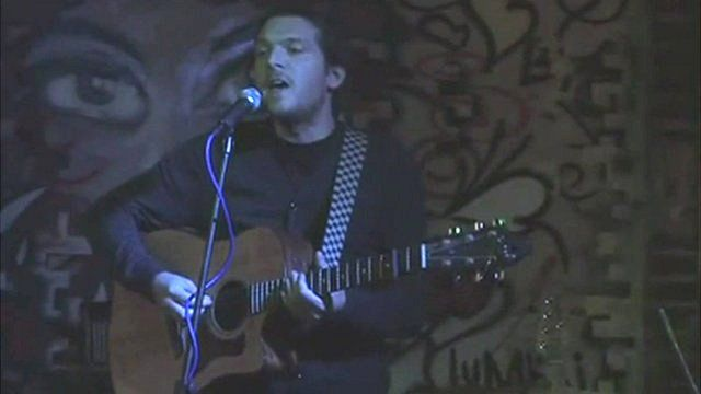 Jeremy Forrest playing the guitar