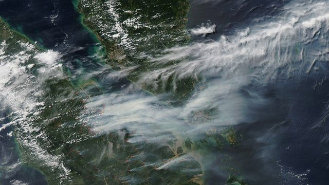 Nasa satellite shows smoke caused by forest fires over southern Malaysia and Singapore