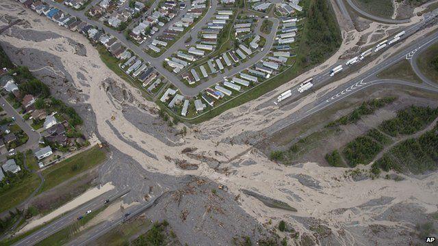 A creek runs across a highway