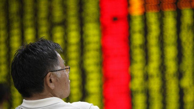 A man watches stock activity at a stock