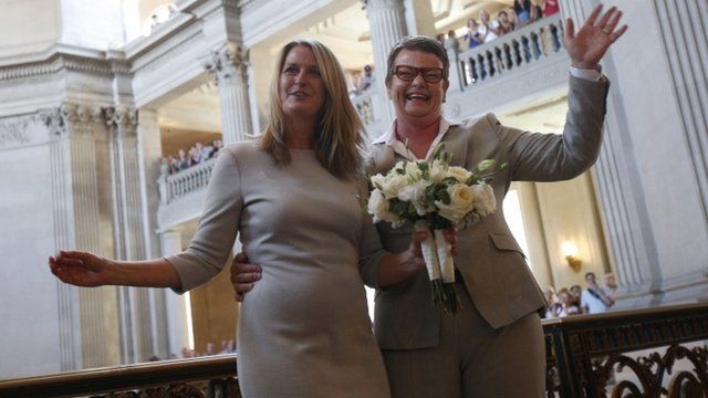 Same-sex couple Stier and Perry wave after getting married in San Francisco