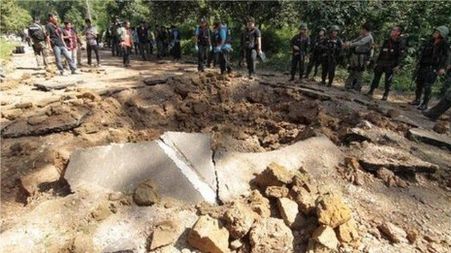 Thai security personnel inspect the site of a bomb attack by suspected Muslim militants on a roadside in Yala province, south of Bangkok, on Saturday
