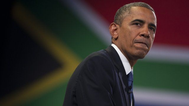 President Obama in front of South African flag