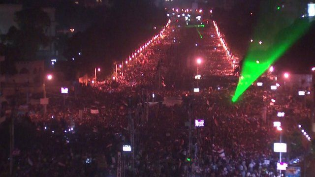 A bridge leading to Tahrir Square filled with protesters and dotted with lasers on the night of June 30 2013