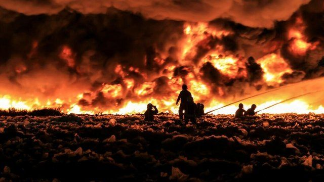 Firefighters tackle a large blaze at a recycling centre in Smethwick near Birmingham