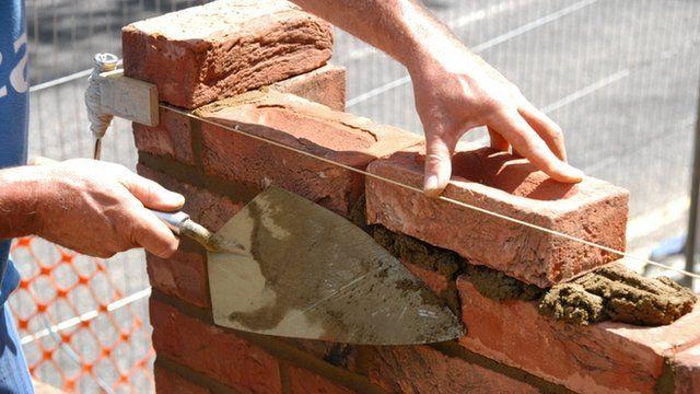 A bricklayer laying bricks