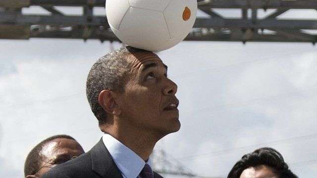"US President Obama balancing ""socketball"" on his head"