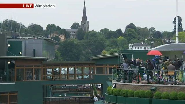 The spire forms the backdrop to Wimbledon