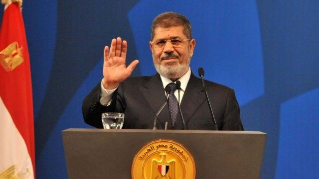 May 29, 2013 handout picture released by Egyptian presidency shows Egyptian President Mohamed Morsi giving the opening speech