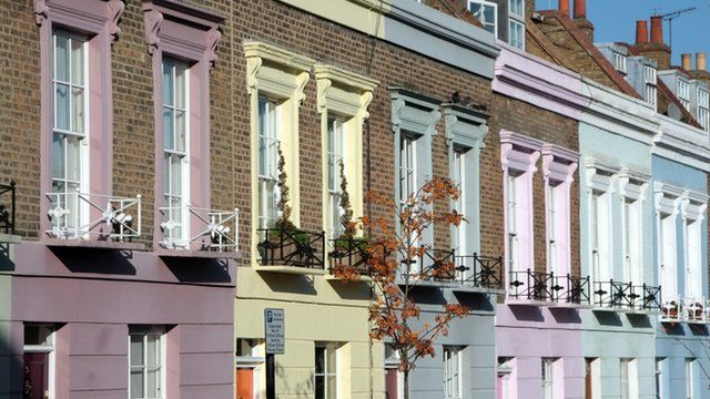 Multi-coloured Victoria terraced houses in Camden Town, north London.
