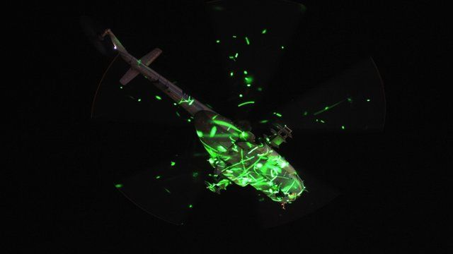 Protesters shine lasers on a military helicopter above Cairo