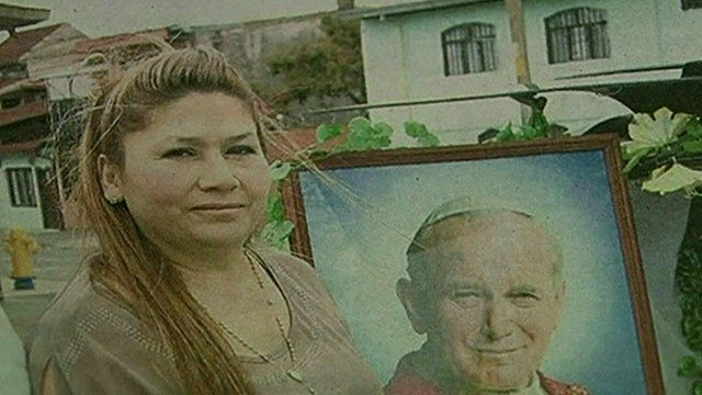 Floribeth Mora with framed image of Pope John Paul II