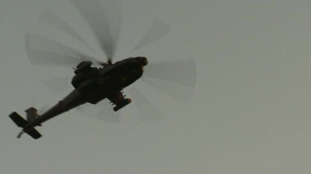 Helicopter flies over Tahrir Square, Egypt