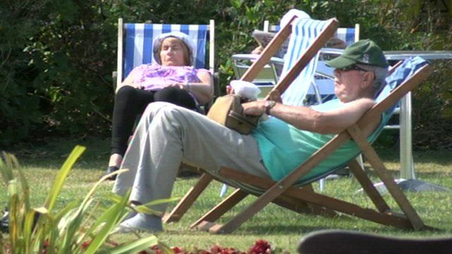 A man and a woman relaxing in the sun