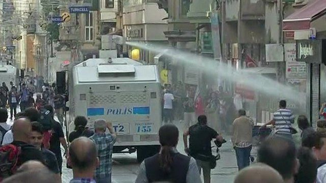 Water cannon on busy street
