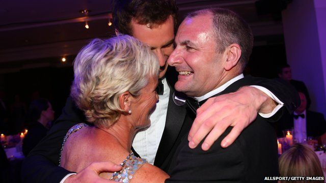 Andy Murray hugs his mum Judy and dad William
